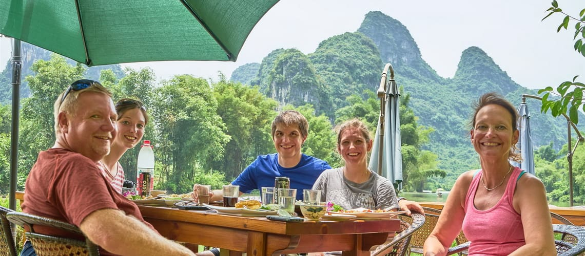 Guilin Yangshuo Mountain Retreat guests lunch by Yulong River best Yangshuo hotels TripAdvisor